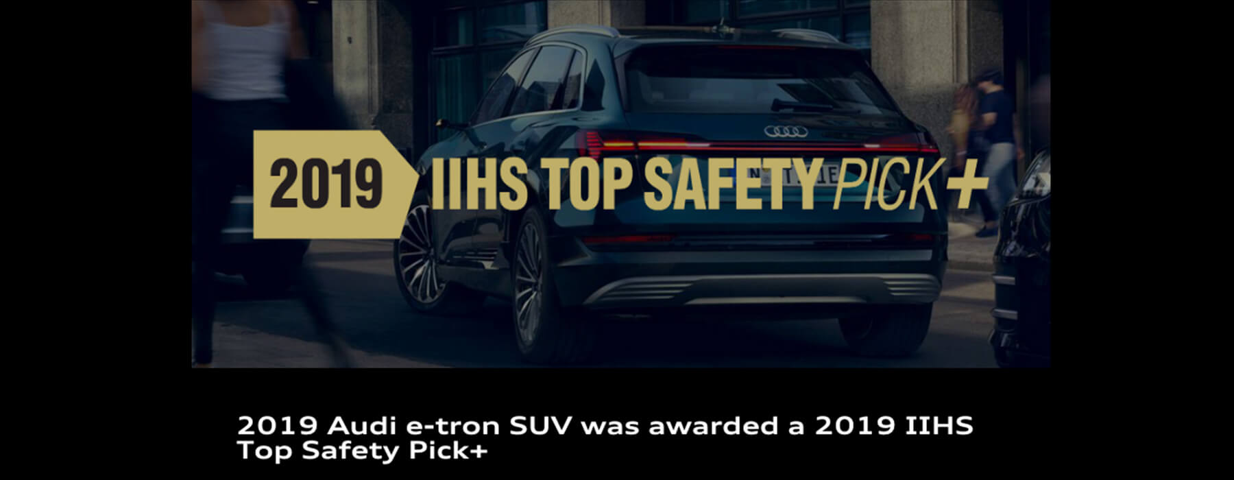 5-Star Safety Rating. More Stars, Safer Cars. US Department of Transportation. 2019 e-tron awarded a NHTSA 5-Star Overall Safety Rating. In the background, blue Audi SUV is towing a row-boat down a road next to the water.