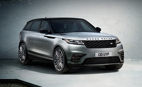 Range Rover Velar in front of grey background