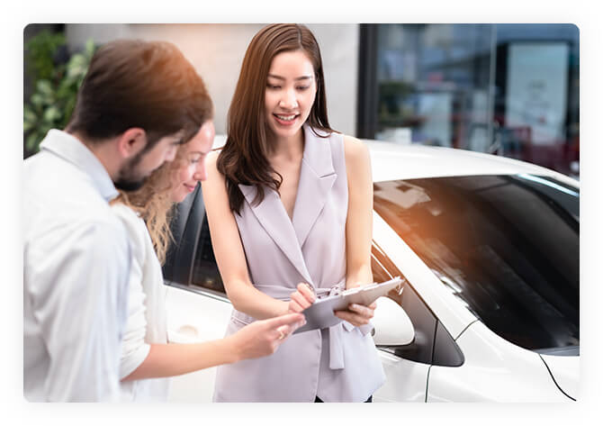 A customer support specialist helping a client purchase a vehicle.